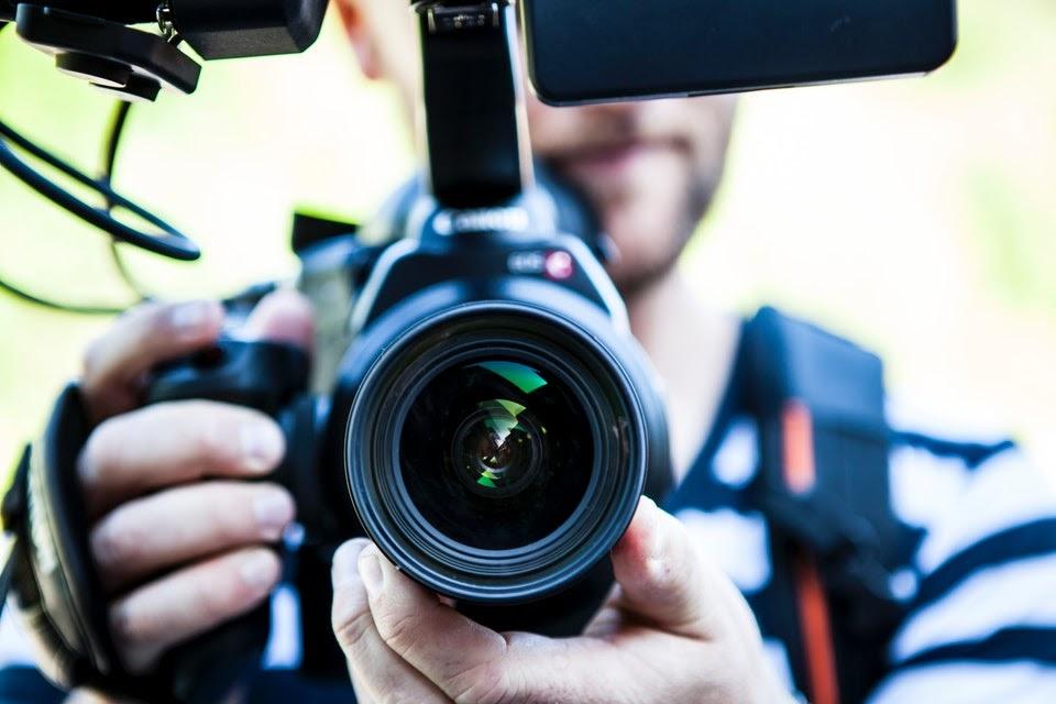 video marketing tips - holding video camera